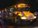 Yellow School Bus belonging to Aksamit Transportation decorated in Christmas Lights for the local holiday parade